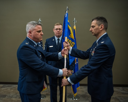 Col. Michael Cruff, commander, 932nd Airlift Wing, left, hands over command of the 932nd AW Medical Group to Col. Christopher Matlack during an Assumption of Command ceremony, Mar. 2, 2019, Scott Air Force Base, Illinois. (U.S. Air Force photo by Master Sgt. Christopher Parr)