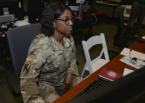 Lt. Col. Anita Vinson, U.S. Army, an exercise planner in U.S. Southern Command's Engineering section conducts a systems check during exercise Integrated Advance 2019.