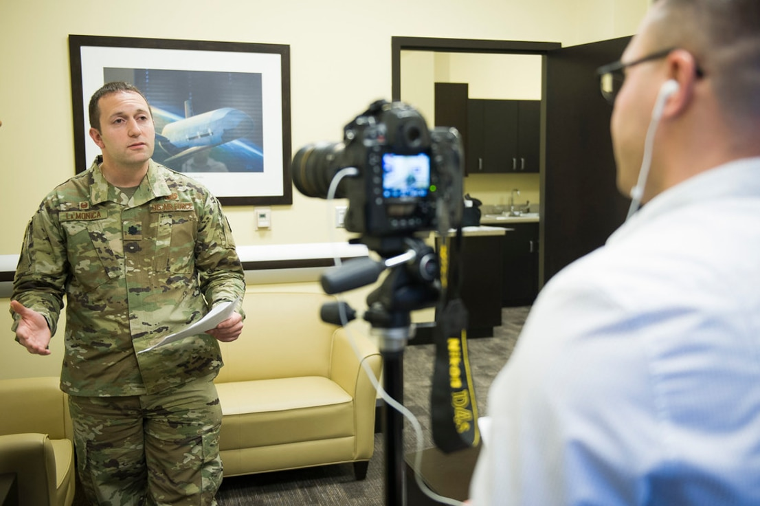 Lt. Col. Joseph La Monica gives an interview to a mock reporter during media training at the 2019 AFDW Squadron Commanders and Spouses Course at Joint Base Andrews, Md., April 16, 2019.
