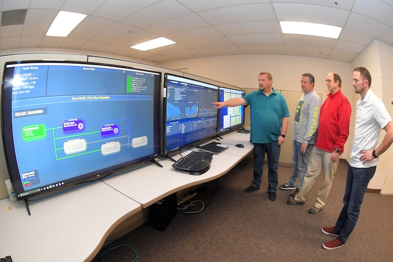 (Left to right) Carl Stucki and Scott Vigil, project directors, David L. Jolley, director, and Brent VanDerMeide, flight director, 517th Software Engineering Squadron, review data March 25, 2019, at Hill Air Force Base, Utah. Software developers in the 517th SWES have developed a new workflow system and software development methodology to significantly reduce the time it takes to deliver software to customers.  (U.S. Air Force photo by Todd Cromar)