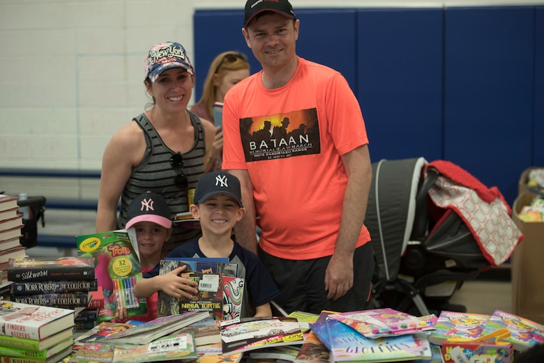 A Family poses during the children's carnival on Holloman Air Force Base, April 6, 2019. Six thousand books were given out during the event. (U.S. Air Force Photo by Staff Sgt. Timothy Young)