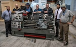 From left to right: Armen Kvryan, Michael Jastrzembski, Tim Tenopir, Keith Sanders, Scott Sanders, Zachary Stephens, and James Powers in front of Lathe, one of the many pieces of equipment used for research and prototype fabrication.