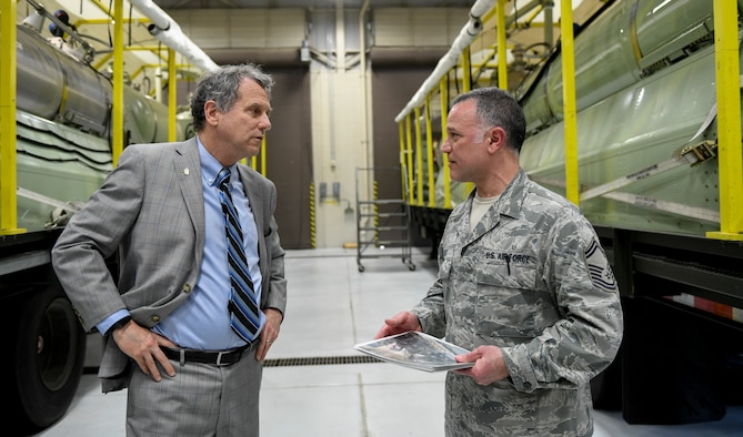 Ohio U.S. Sen. Sherrod Brown, (left) discusses plans for the Modular Aerial Spray System 2.0 with Master Sgt. Phil Aliberti, (right) a spray maintenance supervisor, assigned to the 910th Maintenance Squadron on April 16, 2019, here.