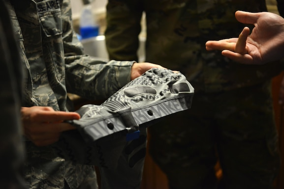 A Beale Airman gets to hold a pair of biometric measuring compression shorts that can assist with the health and stress of the wearer.