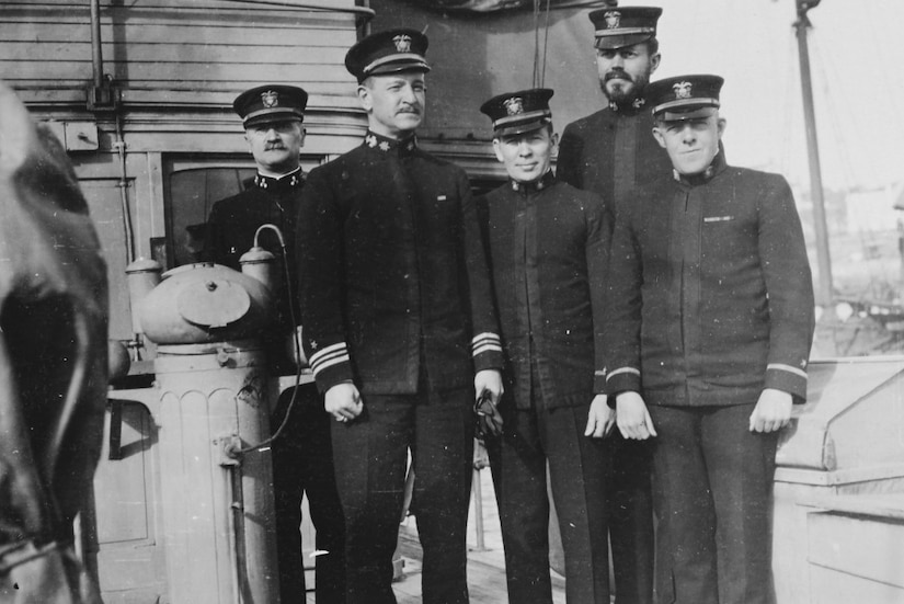 USS Margaret officers stand by the ship's binnacle. Officers include Navy Lt. Cmdr. Frank Jack Fletcher.