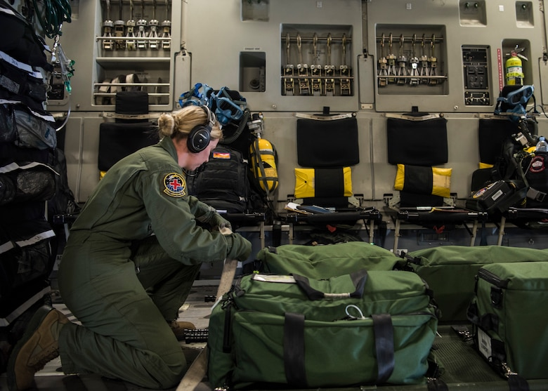 Tech. Sgt. Lindsee Beasley, 42th Air Mobility Wing medical technician, prepares for flight on a C-17 Globemaster III, assigned to Wright-Patterson Air Force Base, Ohio, during exercise Patriot Hook 2019, April 11, 2019, at Vandenberg Air Force Base, Calif. Patriot Hook is an annual joint-service exercise coordinated by the Air Force Reserve Command, designed to integrate the military and first responders of federal, state and local agencies. The exercise provides training for mobilizing quickly and deploying in military aircraft in the event of a regional emergency or natural disaster. (U.S. Air Force photo by Airman 1st Class Aubree Milks)