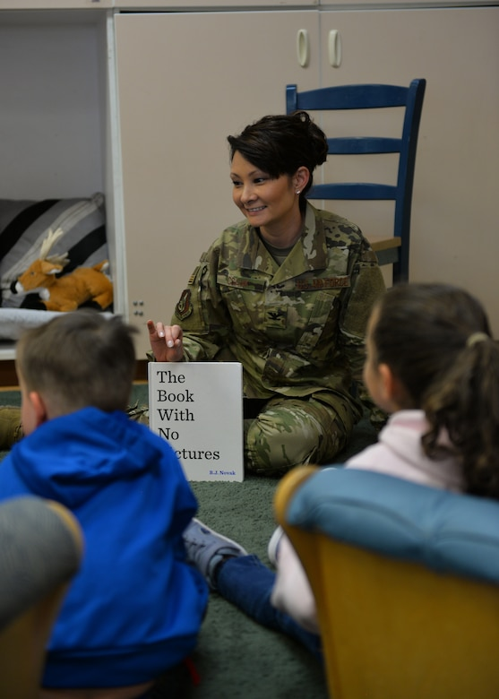 "U.S. Air Force Col. Patricia Csànk, Joint Base Elmendorf-Richardson and 673d Air Base Wing commander, interacts with kids at the Denali Child Development Center, JBER, Alaska, April 8, 2019. In honor of Month of the Military Child, Csànk visited the Denali Child Development Center at JBER to read to some of the children. Out of the selection of four books, the kids elected to read ""The Book With No Pictures,"" by B.J. Novak, knowing all too well what this piece of literature would have Csànk reading aloud."