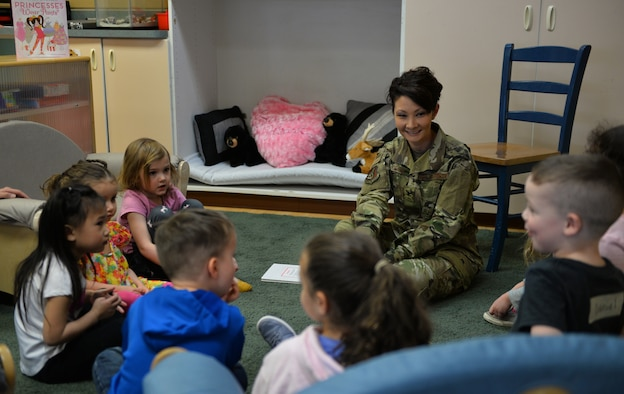 "U.S. Air Force Col. Patricia Csànk, Joint Base Elmendorf-Richardson and 673d Air Base Wing commander, interacts with kids at the Denali Child Development Center, JBER, Alaska, April 8, 2019. In honor of Month of the Military Child, Csànk visited the Denali Child Development Center at JBER to read to some of the children. Out the selection of four books, the kids elected to read ""The Book With No Pictures,"" by B.J. Novak, knowing all too well what this piece of literature would have Csànk reading aloud."