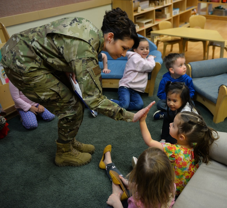 "U.S. Air Force Col. Patricia Csànk, Joint Base Elmendorf-Richardson and 673d Air Base Wing commander, says goodbye to kids at the Denali Child Development Center April 8, 2019, at JBER, Alaska. In honor of Month of the Military Child, Csànk visited the Denali Child Development Center at JBER to read to some of the children. Out the selection of four books, the kids elected to read ""The Book With No Pictures,"" by B.J. Novak, knowing all too well what this piece of literature would have Csànk reading aloud."