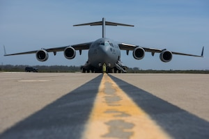 A C-17 Globemaster III, assigned to Wright-Patterson Air Force Base, Ohio, lands during exercise Patriot Hook 2019, April 11, 2019, at Vandenberg Air Force Base, Calif. The 5-day exercise provided realistic mission training for Air Force Reserve Command members and other United States Air Force aircrew. (U.S. Air Force photo by Airman 1st Class Aubree Milks)
