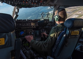 Capt. Jeremiah Brown, 89th Airlift Squadron pilot, operates a C-17 Globemaster III, assigned to Wright-Patterson Air Force Base, Ohio, during Exercise Patriot Hook 2019, April 11, 2019, at Vandenberg Air Force Base, Calif. The C-17 is the most flexible cargo aircraft to enter the airlift force and is capable of rapid strategic delivery of troops and cargo to main operating bases or directly to forward bases. (U.S. Air Force photo by Airman 1st Class Aubree Milks)
