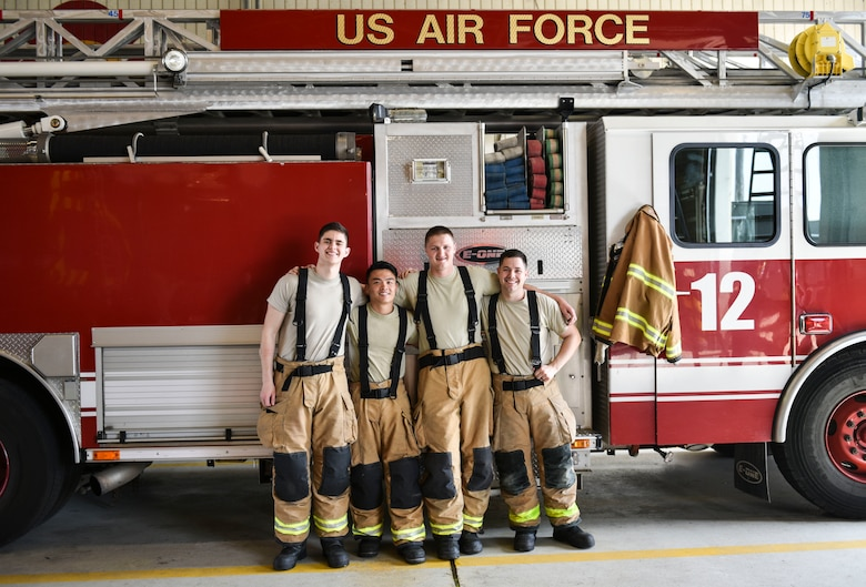 U.S. Air Force Tech. Sgt. Tyler Larimer (second from right), a firefighter from the 176th Civil Engineer Squadron, Joint Base Elmendorf-Richardson, Alaska, poses for a photo with 8th Civil Engineer Squadron firefighters at Kunsan Air Base, Republic of Korea, April 17, 2019. Larimer immersed himself with the 8th CES fire department and responded to several calls, gaining experience on flight line and aircraft fire operations. (U.S. Air Force photo by Senior Airman Stefan Alvarez)