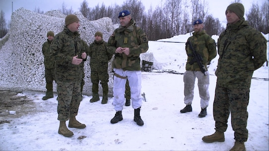 U.S. Marine Corps Lt. Col. Scott D. Welborn, the commanding officer of 2nd Air Naval Gunfire Liaison Company, II Marine Expeditionary Force Information Group, recognizes Brig. Gen. Lars S. Lervik, the commander of the Norwegian Brigade North, for participating in the Artic Ribbon ceremony in Haparanda, Sweden, March 20, 2019. During exercise Northern Wind, Marines with 2nd ANGLICO were awarded for their time training in the Arctic Circle during Cold Weather Operations Training. This Cold Weather Operations Training is the entry level cold weather training for Norwegian soldiers. (U.S. Marine Corps photo by Sgt. Luisa F. Torres)