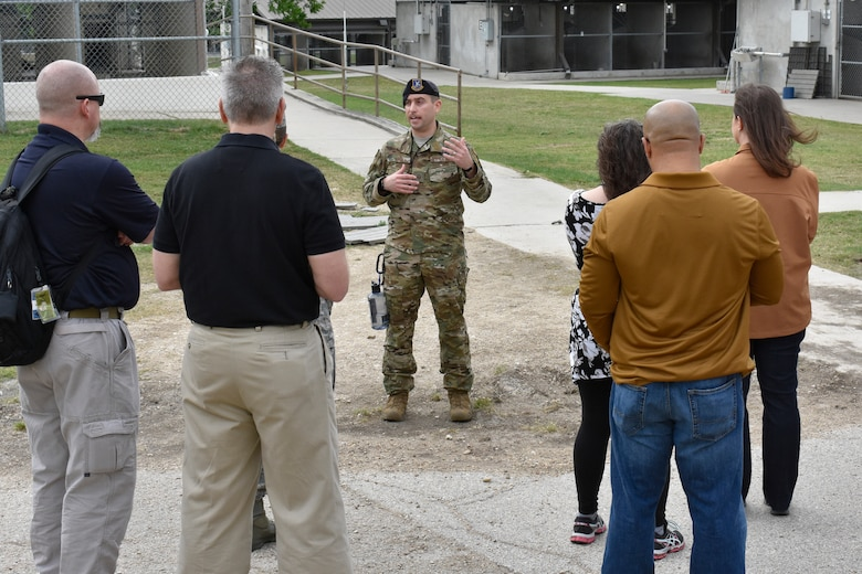 Master Sgt. Steve Kaun, Air Force Military Working Dog Program Manager, gives the government-wide working dog team members a tour of 341st Training Squadron's military working dog kennels on Joint Base San Antonio-Lackland, Texas, April 16, 2019. The 341st TRS provides training to MWDs used in patrol, drug and explosive detection, and specialized mission functions for the DoD and other government agencies. (U.S. Air Force photo by Shannon Carabajal)
