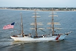 oast Guard Cutter Eagle transits down the Savannah River towards Savannah, Georgia, Mar. 15, 2019, in front of the Tybee Island Lighthouse. The Eagle arrived in Savannah for St. Patrick's Day weekend with over 100 guests on board.