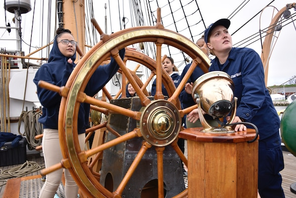 Students from the New London High School ROTC help steer the Coast Guard Cutter Barque Eagle May 10, 2018. The cutter is about underway to New London, Connecticut with members of the Coast Guard Foundation, Coast Guard Academy, New London Rotary Club and students in the New London High School Navy ROTC.