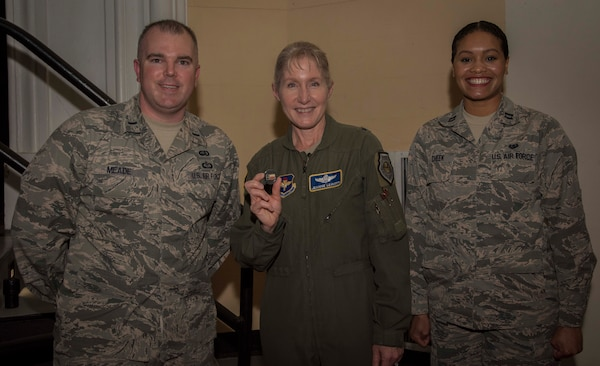 First Lt. Kiely Meade, officer in charge of Transitions Operations Headquarters Air Force Personnel Center, and Capt. Dayna Cheek, chief of adverse actions, 502d Security Forces Group, pose with Brig. Gen. Jeannie Leavitt, commander of Air Force Recruiting Service, April 10, 2019, in the Fleenor Auditorium, Joint Base San Antonio-Randolph, after they coined her. The purpose of this event was to provide an opportunity for the JBSA community to hear, ask questions and learn from a leader like Brig. Gen. Leavitt as she shares her story as the first female fighter pilot and the first woman to command an Air Force combat fighter wing and talks about effective leadership practices in the Air Force. (U.S. Air Force photo by: Airman 1st Class Shelby Pruitt)