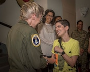 Alicia Figiuolo, U.S. Marine Corps veteran, shakes the hand of Brig. Gen. Jeannie Leavitt, commander of Air Force Recruiting Service, April 10, 2019, in the Fleenor Auditorium, Joint Base San Antonio-Randolph. The purpose of this event was to provide an opportunity for the JBSA community to hear, ask questions and learn from a leader like Brig. Gen. Leavitt as she shares her story as the first female fighter pilot and the first woman to command an Air Force combat fighter wing and talks about effective leadership practices in the Air Force. (U.S. Air Force photo by: Airman 1st Class Shelby Pruitt)