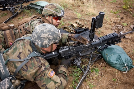 New York Army National Guard Soldiers assigned to Alpha Company, 1st Battalion, 69th Infantry Regiment, fire a Squad Automatic Weapon at Camp Santiago, Puerto Rico, on  April 13, 2019. While in Puerto Rico the Soldiers honed their fighting skills by practicing short-range marksmanship techniques.
