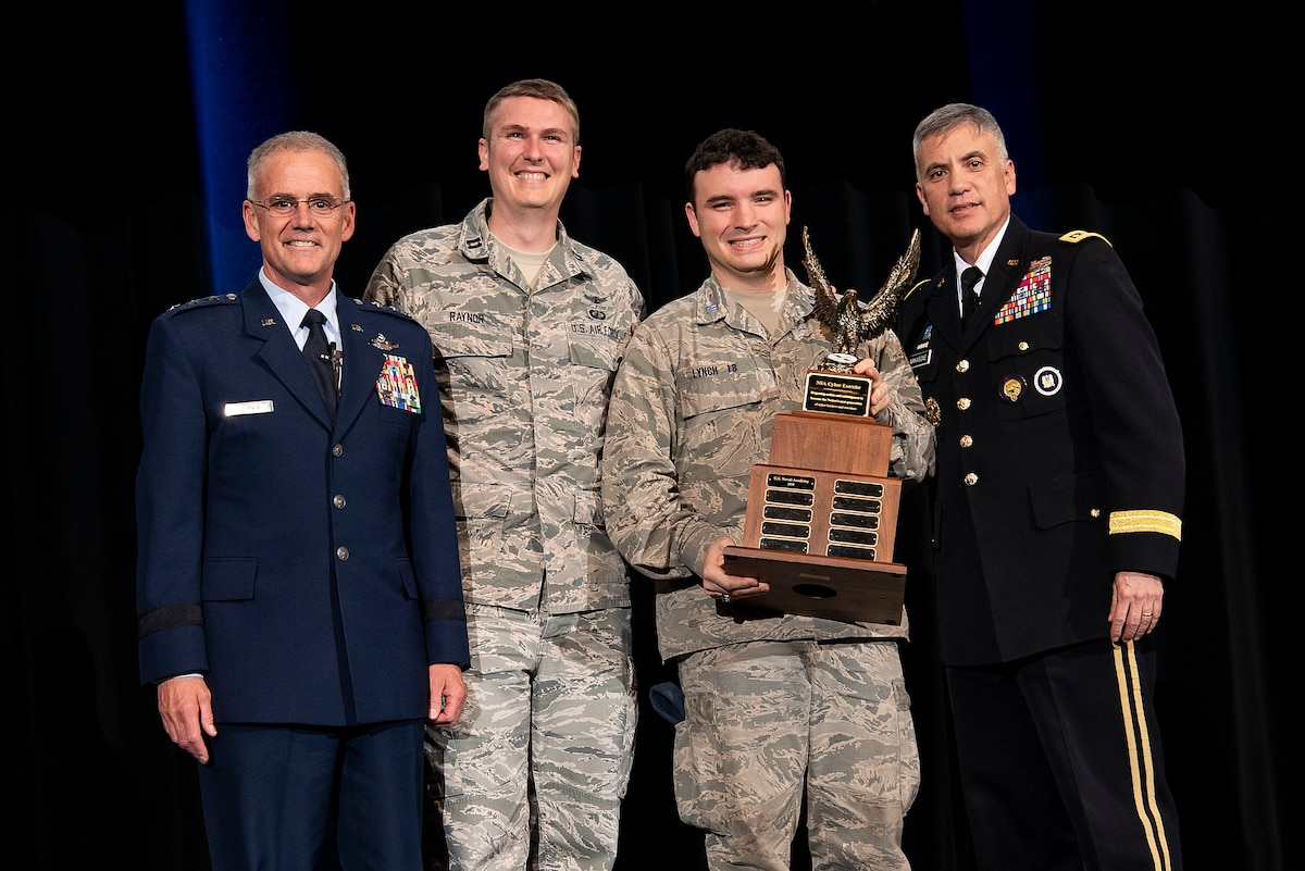 Lt. Gen. Jay B. Silveria Superintendent of the United States Air Force Academy, Capt. Justin Raynon, Cadet James Lynch, Gen. Paul M. Nakasone, Commander U.S. Cyber Command, and Director, National Security Agency/Chief, Central Security Service