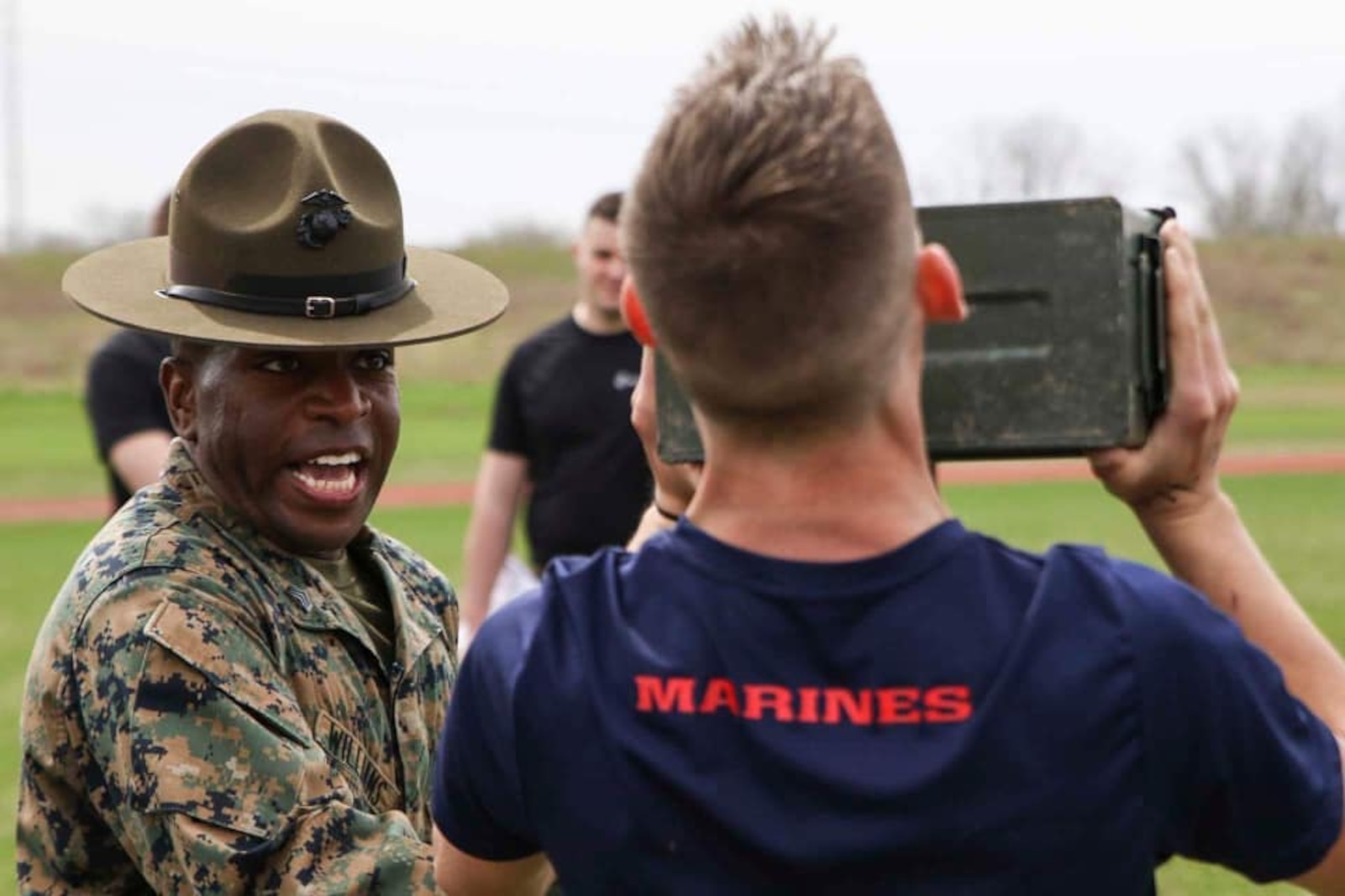 Sergeant Kevin Williams, a drill instructor with Marine Corps Recruit Depot San Diego, California, instructs a poolee how to properly lift ammo cans during the combat fitness test at an all-hands pool function. Recruiting Station Indianapolis hosted the pool function to simulate recruit training, while preparing  the poolees to deal with the stress and high tempo during the 13-week training regimen. (Official U.S. Marine Corps photo by Sgt. Carl King/Released)