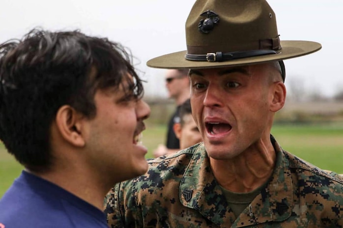 Sergeant Matthew Schihl, a drill instructor with Marine Corps Recruit Depot San Diego, California, motivates a poolee during the combat fitness test at an all-hands pool function. Recruiting Station Indianapolis hosted the pool function to simulate recruit training, while preparing  the poolees to deal with the stress and high tempo during the 13-week training regimen. (Official U.S. Marine Corps photo by Sgt. Carl King/Released)