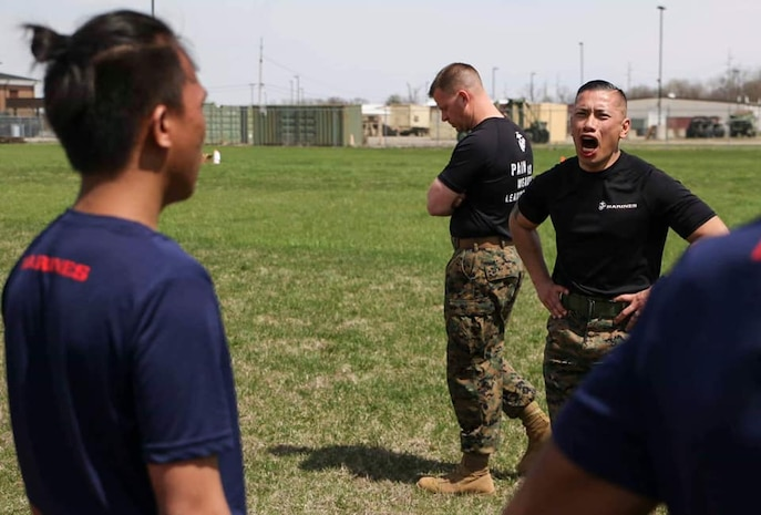 Sergeant Maj. Lester Abanto, Recruiting Station Indianapolis sergeant major, motivates poolees during the RS all-hands pool function, April 13, in Indianapolis, Indiana. Recruiting Station Indianapolis hosted the pool function to simulate recruit training, while preparing  the poolees to deal with the stress and high tempo during the 13-week training regimen. (Official U.S. Marine Corps photo by Sgt. Carl King/Released)