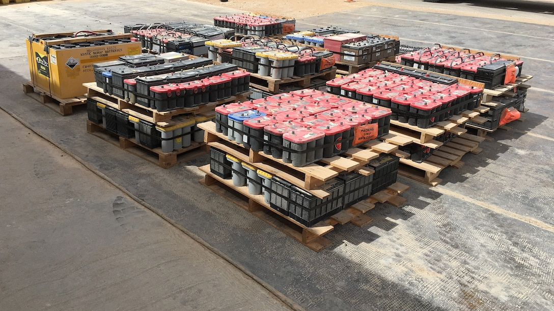 More than 14,000 pounds of lead acid batteries are arranged on pallets for transport