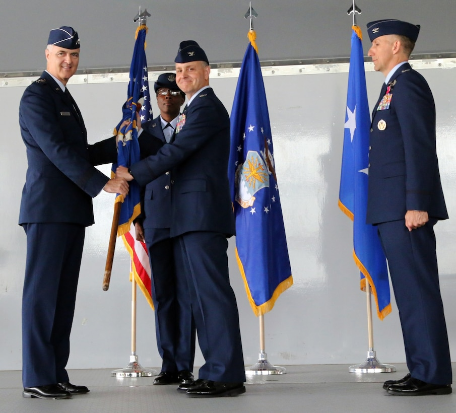U.S. Air Force Col. Mark Wootan (center) receives the CAP-USAF guidon, emblematic of command, from Lt. Gen. R. Scott Williams, Commander, Continental U.S. North American Aerospace Defense Command Region –1st Air Force (Air Forces Northern). At their left is Wootan's predecessor as CAP-USAF commander, Col. Michael Tyynismaa. (CAP-USAF courtesy photo)