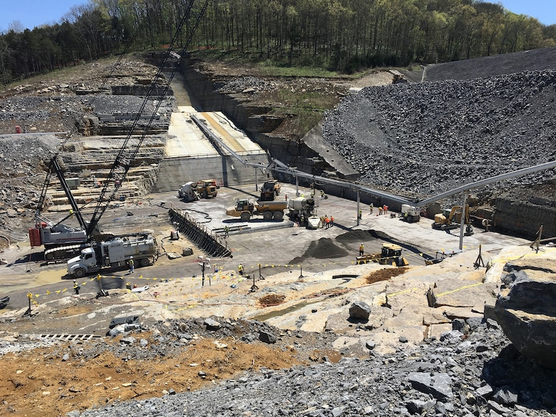 """LANCASTER, Tenn. (April 18, 2019) – The U.S. Army Corps of Engineers recently began placing """"roller-compacted concrete"""" to build a reinforcing berm downstream of Center Hill's auxiliary dam.  This construction is the final major risk-reduction contract in the ongoing Center Hill Dam Safety Rehabilitation Project."""