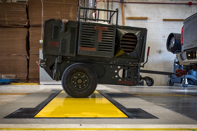 The 92nd Logistics Readiness Squadron utilizes the newly implemented Weigh-In-Motion scale to expedite cargo deployment functions with a more accurate and efficient process at Fairchild Air Force Base, Washington, April 17, 2019. This innovation reduces the entire process to be as simple as driving over a plate in the ground to display the weight, dimensions and center of balance in one step. U.S. Air Force photo by Airman 1st Class Whitney Laine)