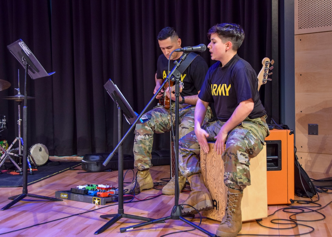 """U.S. Army Reserve Spc. Laura Crespo, a bandsman for the 78th Army Band, performs """"Time after time"""" with Spc. Luis Gastaliturris, a bandsman with the 78th Army Band, for the West End House Boys and Girls Club in Allston, Massachusetts, April 12. Crespo is a senior at Berklee School of Music. The U.S. Army Reserve provided Crespo with opportunities away from her hometown in Puerto Rico. """"My mom always said take the first opportunity to leave Puerto Rico, and make a life out there,"""" said Crespo."""