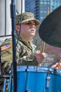U.S. Army Reserve Spc. Laura Crespo, a bandsman for the 78th Army Band, performs with the 78th Army Band Jazz Combo during the Meet Your Army Week event in the Boston Commons, in Boston, Massachusetts, April 13. The U.S. Army offers 150 career choices. Army musicians perform in a variety of ensembles ranging from ceremonial band to jazz band to small ensembles, playing all styles of music.