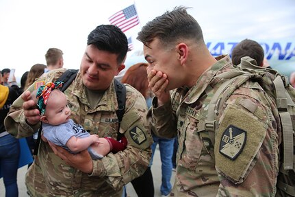 """Approximately 100 Soldiers from Echo Battery, 1st Battalion, 145th Field Artillery, """"Big Red"""" return from a 10-month Middle East deployment April 9."""