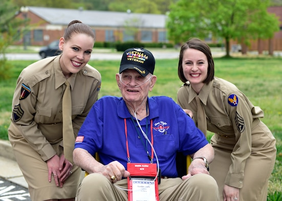Tech. Sgt. Ashley Keeks and Tech. Sgt. Adrienne Kling, U.S. Air Force Singing Sergeants sopranos, pose with a retired Vietnam veteran before a DFW Honor Flight concert, at Joint Base Anacostia-Bolling, April 13, 2019. The USAF Concert Band and Singing Sergeants honored military veterans from WWII, Vietnam and Korean War by playing music from the era. (U.S. Air Force photo by Staff Sgt. Cary Smith)