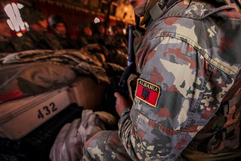 The patch of Albania is visible on a soldier's sleeve.