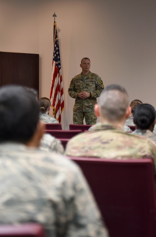 The 19th Air Force Command Chief Master Sgt. Erik Thomson speaks during an enlisted all call April 8, 2019, on Columbus Air Force Base, Mississippi. The visit was the first time Thomson had seen Columbus AFB and he said he was glad to have the opportunity to see and meet the Airmen of the pilot training wing firsthand. (U.S. Air Force photo by Airman 1st Class Keith Holcomb)