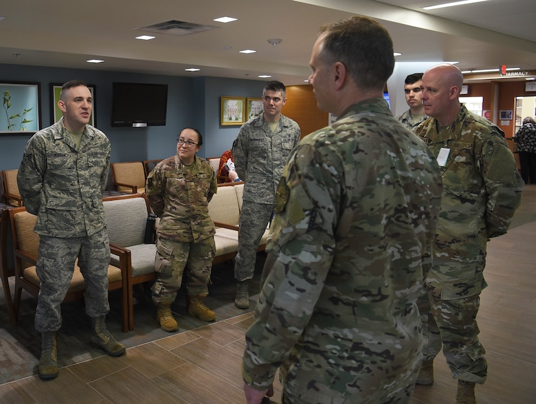 Senior Airman Kevin Morgan, 14th Medical Operations Squadron bioenvironmental technician, speaks with 19th Air Force Command Chief Master Sgt. Erik Thomson April 8, 2019, on Columbus Air Force Base, Mississippi. Morgan was coined by Thomson for his actions assisting people involved in a car accident and his consistent excellence in his career field. (U.S. Air Force photo by Airman 1st Class Keith Holcomb)