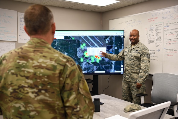 Tech. Sgt. Quincy Harris, 14th Communications Squadron section chief, speaks about Spark Cell innovations helping their unit with 19th Air Force Command Chief Master Sgt. Erik Thomson April 8, 2019, on Columbus Air Force Base, Mississippi. In the visit to the Spark Cell different project leads mentioned the collaborative work from numerous bases, units, and individuals. (U.S. Air Force photo by Airman 1st Class Keith Holcomb)