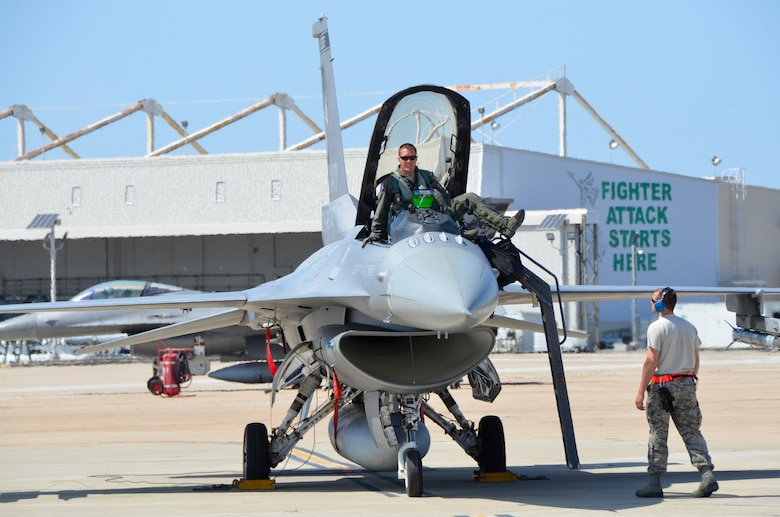 Maj. Ryan Stott, a pilot with the 114th Fighter Wing, exits an F-16C Fighting Falcon during Lobo Plummet at Marine Corps Air Station Miramar, California, March 2019.