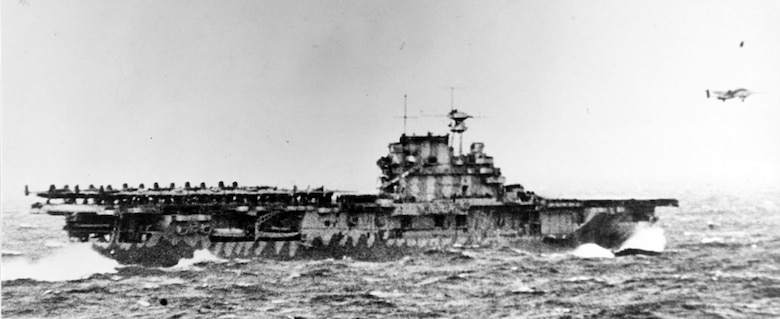The USS Hornet, a U.S. Navy vessel, launches Doolittle's force at the start of the first U.S. air raid on the Japenese home lands. On 18 April 1942, airmen of the US Army Air Forces, led by Lt. Col. James H. (Jimmy) Doolittle, carried the Battle of the Pacific to the heart of the Japanese empire with a surprising and daring raid on military targets at Tokyo, Yokohama, Yokosuka, Nagoya, and Kobe. This heroic attack against these major cities was the result of coordination between the Army Air Forces and the US Navy, which carried the sixteen North American B-25 medium bombers aboard the carrier USS Hornet to within take-off distance of the Japanese Islands. Here, a pair of alert escorts follow the USS Hornet to protect her lethal cargo of B-25 bombers. (Courtesy Photo)