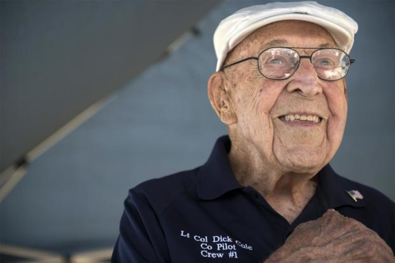 "Retired Lt. Col. Richard E. Cole, co-pilot to Jimmy Doolittle during the Doolittle Raid, smiles as he honors the U.S. flag during the singing of the National Anthem at an airshow in Burnet, Texas. Cole passed away April 8, 2019, and will be honored during a memorial service at Joint Base San Antonio-Randolph, Texas, on the 77th Anniversary of the Doolittle Raid, April 18, 2019. For more information, see the bottom of the article ""77 Years of Courage"". (U.S. Air Force photo by Staff Sgt. Vernon Young Jr.)"