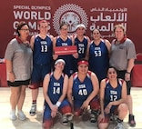 Joint Base San Antonio-Fort Sam Houston Army & Air Force Exchange Service associate Jamie Holt (back row, holding sign) recently returned from competing in the Special Olympics World Games in Abu Dhabi as a member of the U.S. women's basketball team.