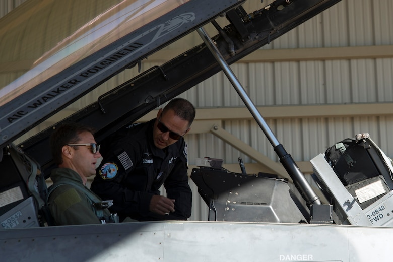 U.S. Air Force Master Sgt. Chris Schneider, F-16 Viper Demonstration Team superintendent, back, helps Townsend Bell, sports commentator and professional race car driver, prepare for flight at Shaw Air Force Base, S.C., April 16, 2019.