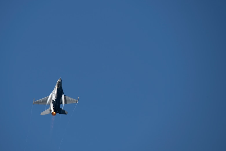 U.S. Air Force Maj. Garret Schmitz, F-16 Viper Demonstration Team safety observer and 55th Fighter Squadron pilot, takes off in an F-16D Viper with Townsend Bell, sports commentator and professional race car driver, at Shaw Air Force Base, S.C., April 16, 2019.