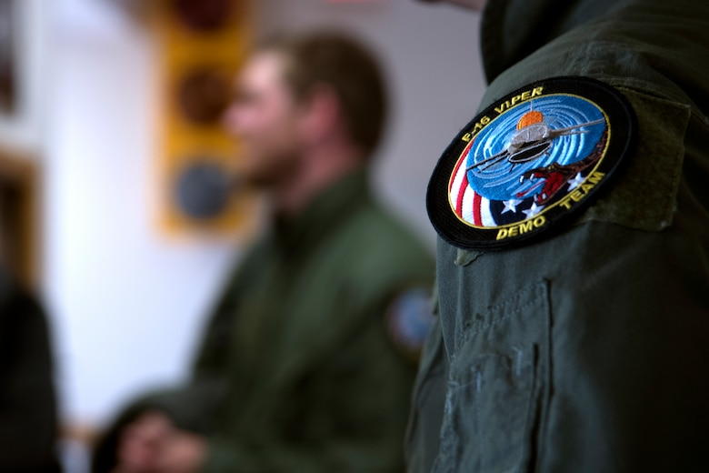 An F-16 Viper Demonstration Team patch rests on the shoulder of Townsend Bell, sports commentator and professional race car driver, at Shaw Air Force Base, S.C., April 16, 2019.