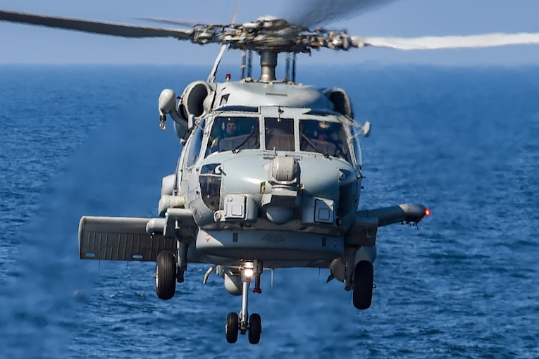A Seahawk helicopter  flies over the Baltic Sea.