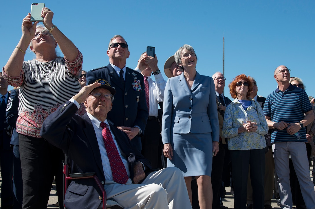 "The family of retired U.S. Air Force Lt. Col. Richard ""Dick"" E. Cole, Chief of Staff of the Air Force General Goldein, and Secretary of the Air Force Heather Wilson watch the T-38C Talon Missing Man flyover during a memorial service celebrating Cole's life at Joint Base San Antonio-Randolph, Texas, April 18, 2019."