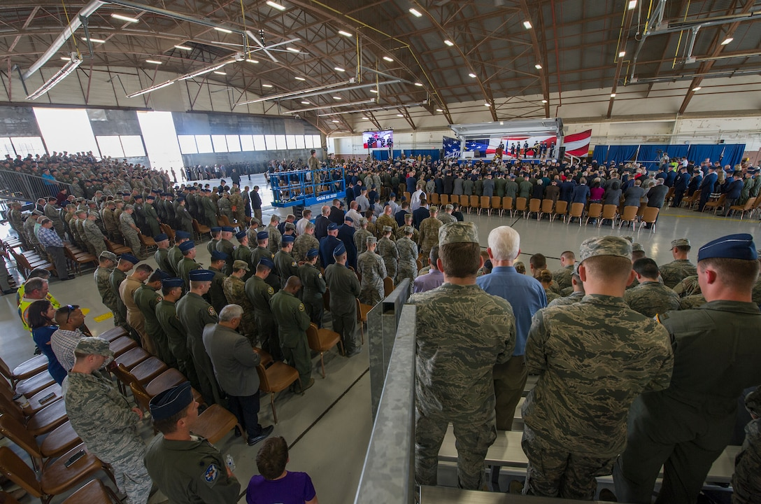 "Attendees bow their heads during the invocation at a memorial service for retired U.S. Air Force Lt. Col. Richard ""Dick"" E. Cole at Joint Base San Antonio-Randolph, Texas, April 18, 2019."