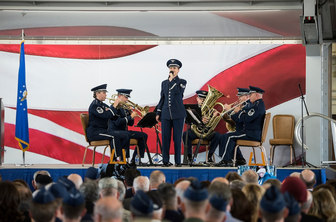 """U.S. Air Force Staff Sgt. Michelle Doolittle, a descendant of Gen. Jimmy Doolittle, sings """"America the Beautiful"""" during a memorial service celebrating the life of retired U.S. Air Force Lt. Col. Richard """"Dick"""" E. Cole at Joint Base San Antonio-Randolph, Texas April 18, 2019."""